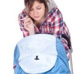 rauchende Mutter mit Kinderwagen